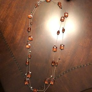 Peach colored gem long necklace. Can layer it once